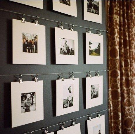 Ikea curtain rod and unframed photos. simple artsy photo gallery wall.