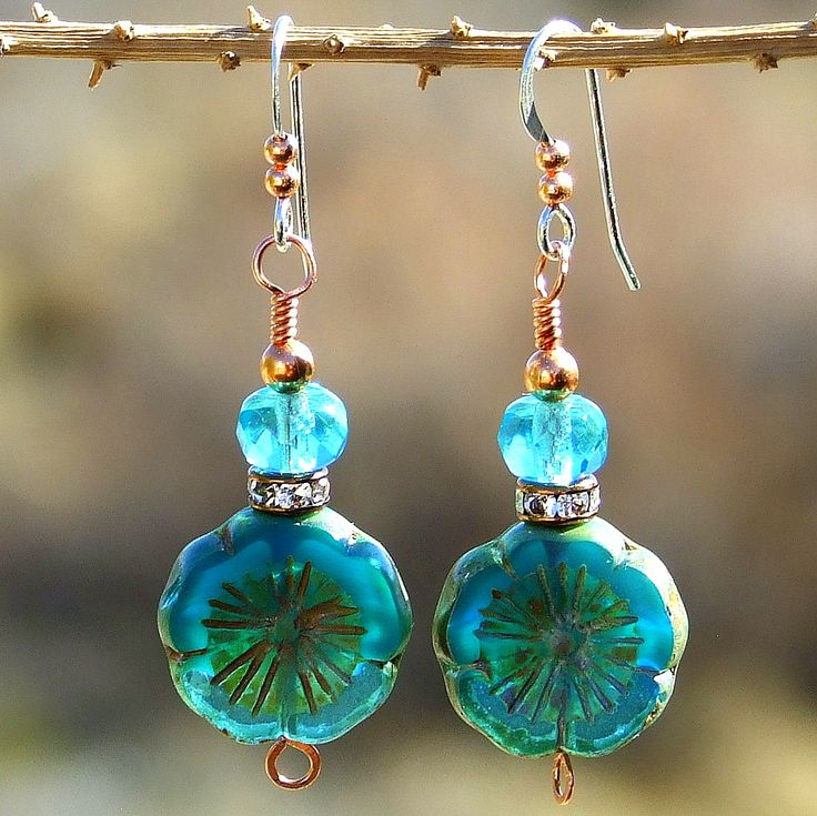 Simply charming and sweetly sparkly with a rich aqua teal color, the OCEAN PANSY flower earrings will take you beautifully through spring and summer, becoming one of your favorite pair of earrings. The beauties feature pansy shaped Czech glass beads in a mix of Caribbean sea colors, some of the glass translucent and some of the glass opaque.