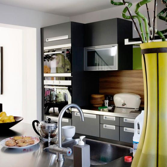 Reminds me of our kitchen!  Dark grey cabinets, warm wood, stainless countertop, green, yellow.