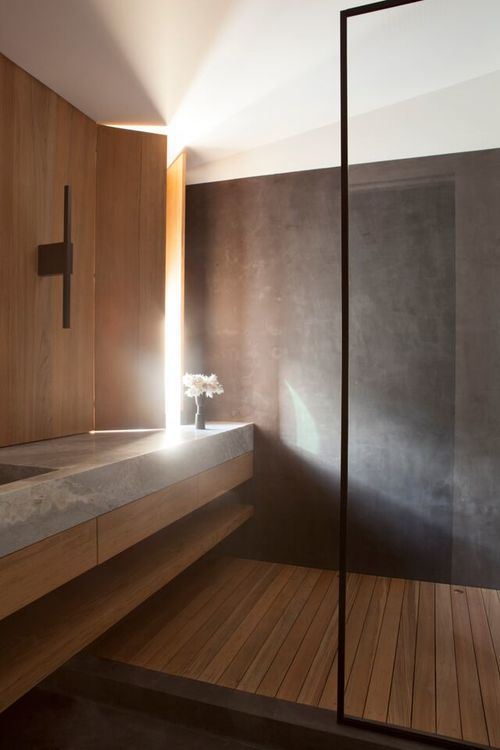 Lighting in Clements Design bathroom featuring wood, stone, metal