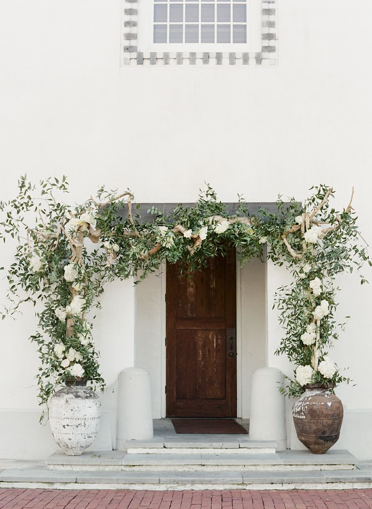 Rosemary Beach Wedding, Alys Beach wedding, Seaside wedding, flower entrance to Rosemary Town Hall, white hydrangea, white roses.  Floral design by Nouveau.
