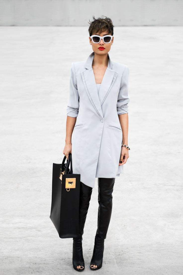 Dress to impress in a grey coat. For the maximum chicness rock a pair of black leather over the knee boots.  Shop this look for $97:  http://lookastic.com/women/looks/black-tote-bag-black-over-the-knee-boots-black-and-white-sunglasses-grey-coat/4641  — Black Leather Tote Bag  — Black Leather Over The Knee Boots  — Black and White Sunglasses  — Grey Coat