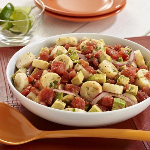 Ensalada de Palmitos: Receta de ensalada con palmitos, tomates y aguacate cubiertos con un aderezo sencillo de cilantro y jugo de limón verde