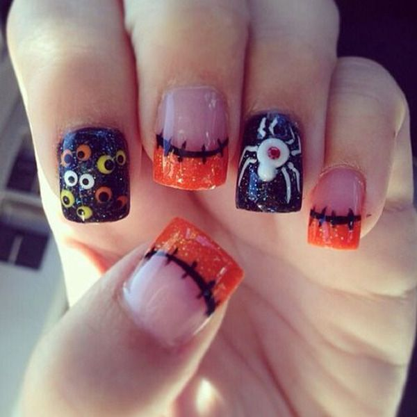 Get more quirky with this fun looking Halloween nail art design. Have fun with orange and black glitter paint and don't forget to add creepy eyes and a huge spider to complete the look.