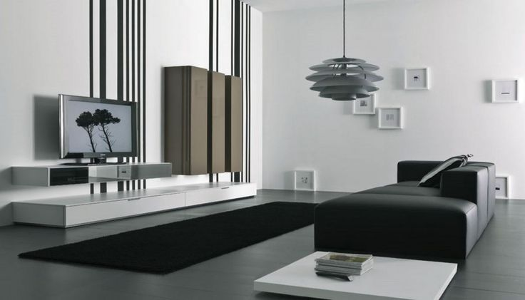 Living Room. Attractive Interior Living Room Design Furniture and Decoration Ideas. Minimalist Neutral Black and White Futuristic Living Room Design ideas with Modern Wall Mounted TV Unit Panel and Low Console Drawers plus Brown Wooden Cabinet and also Modern Black Leather Sofa with Low White Side Table and Unique Gray Stacked Shaped Pendant Light. Minimalist Futuristic Living Room Design. Futuristic Living Room Design Concepts. Futuristic Wall Cabinet. Futuristic TV Wall Unit. Futuristic…