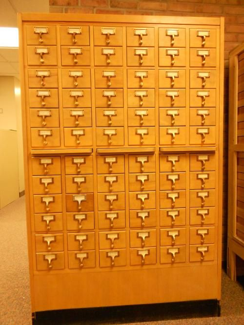 After sitting in our garage for over a year, an old piece of a library becomes my repurposed card catalog - stop by and see how we did it!