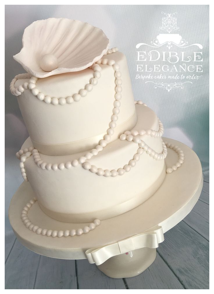 30th Pearl Anniversary cake, hand made lustred shell and pearls.                                                                                                                                                                                 More