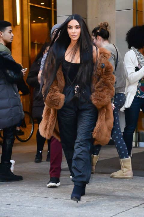 In a brown fur coat, black tank top, drawstring sweat pants and black ankle boots while out in New York.