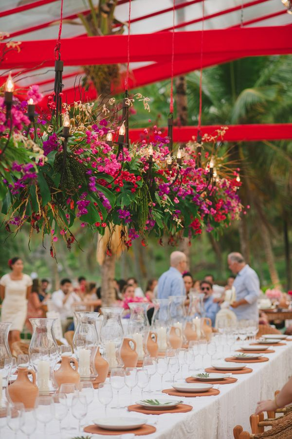 hanging floral arrangements - photo by Piteira Photography http://ruffledblog.com/brazilian-wedding-on-the-beach