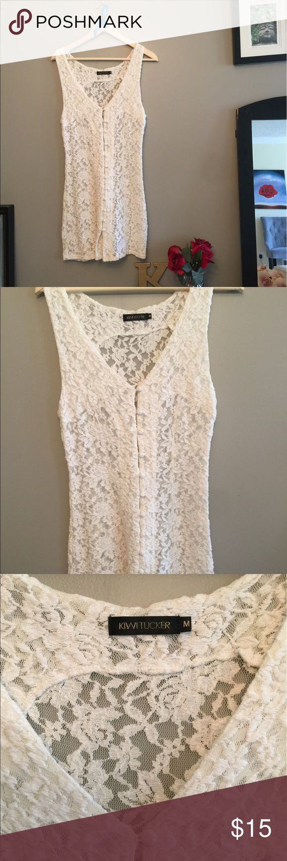 Kiwi Tucker white lace dress This is a reposh, unfortunately it was too big on me in the bust area. Would be great for someone with big boobies! It's completely sheer btw! Use as a swimsuit cover up? Kiwi Tucker is a great Australian brand. One of the buttons is unraveling a bit as pictured. Bundle and save! Kiwi Tucker Dresses Mini