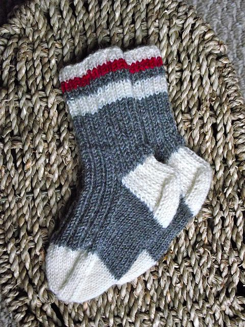 This is a cute variation on a basic baby/child's sock pattern. It makes a great baby shower gift - and when they are out grown, hang them up as a decoration!