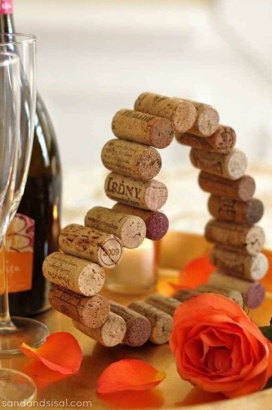 Mise en place di matrimonio: centrotavola tema vino