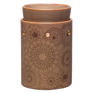 Like the traditional body art application of henna, intricate patterns adorn a glazed cream backdrop. To purchase, go to www.jenni.scentsy.com.au