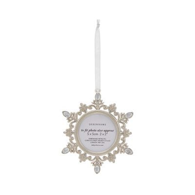 Add some festive cheer to your Christmas decor with this pretty silver plated decoration. Featuring an intricate snowflake design complete with gem embellishments and a small photo frame to display loved ones, it has a ribbon hanging loop.