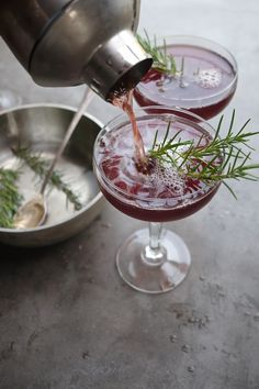 Pomegranate Manhattan. Rosemary simple syrup (rosemary, water, sugar), unsweetened pomegranate juice, bourbon.