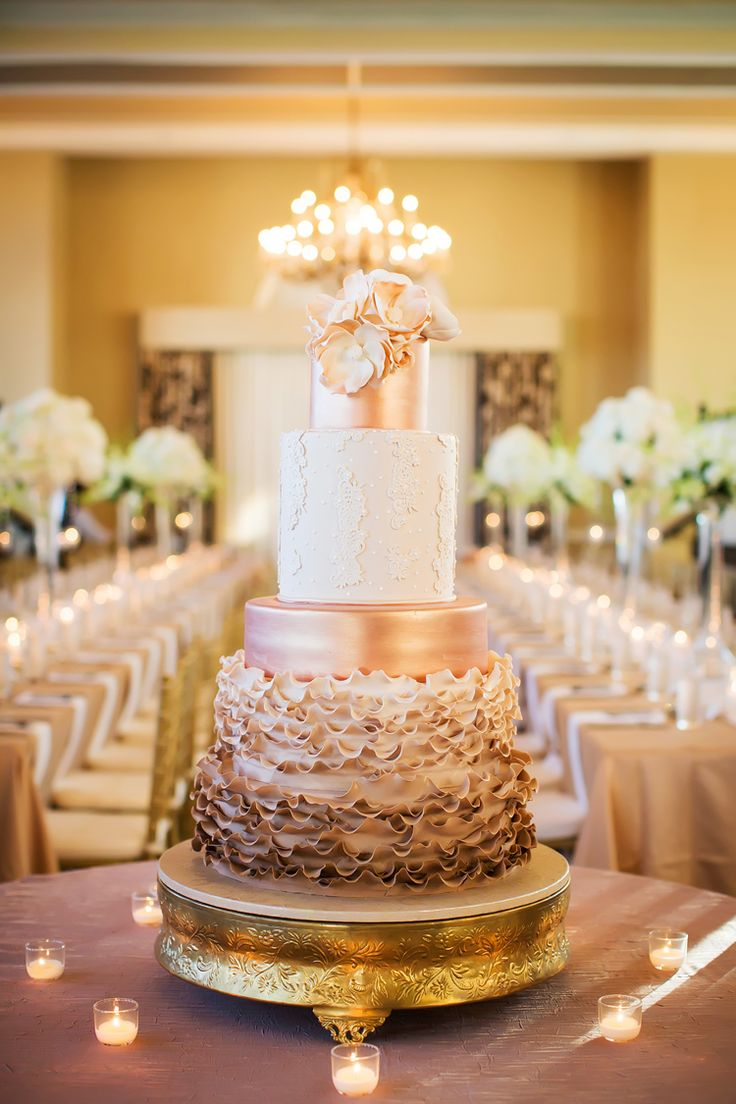 Romantic metallic rose gold wedding cake with floral topper (Limelight Photography)