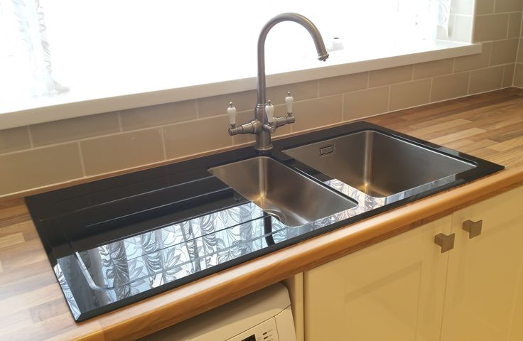 The Bluci KBV651BK.  Glass sink with stainless bowls.  Thanks to our customer who provided this image.  Set into a wooden worksurface with a  three way water filter kitchen tap.