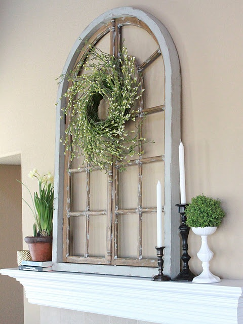 spring vignette. window frame, wreath, moss ball topiary, books... perfect.