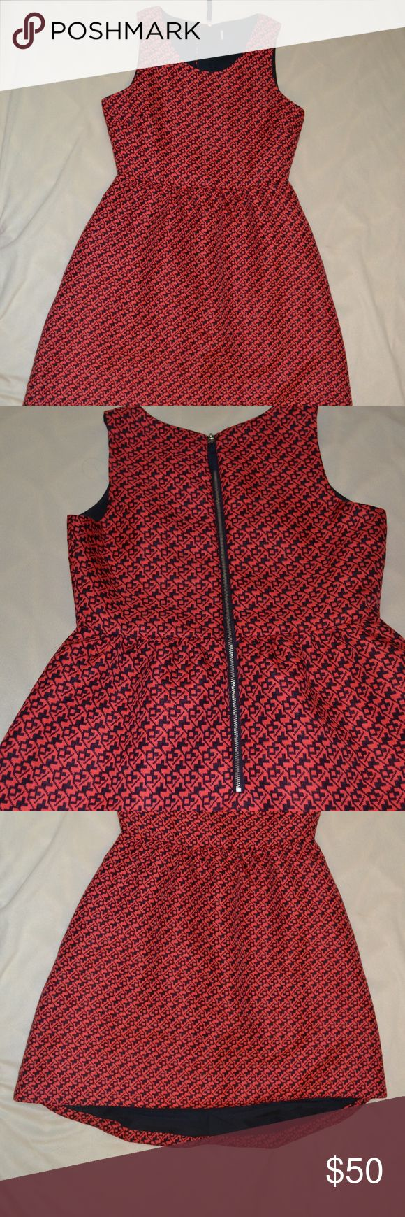 Coral Anthropology Dress Coal and navy houndstooth print Size 4/6 Worn once or twice  Thick, embroidered material I'm 5'3 and it comes down to just above my knee in front, and just below my knee in back Anthropologie Dresses