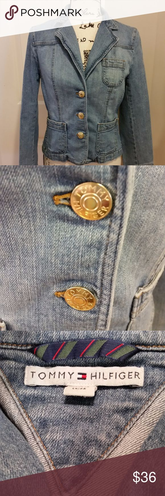 TOMMY HILFIGER Denim Jackekt Three shiny logo buttons adorn the closure on this slightly weathered denim jacket with two small front patch pockets and demure breast pocket. Easy to wear and the perfect complement for your favorite jeans or skirts. EUC. Now flaws. Tommy Hilfiger Jackets & Coats Jean Jackets