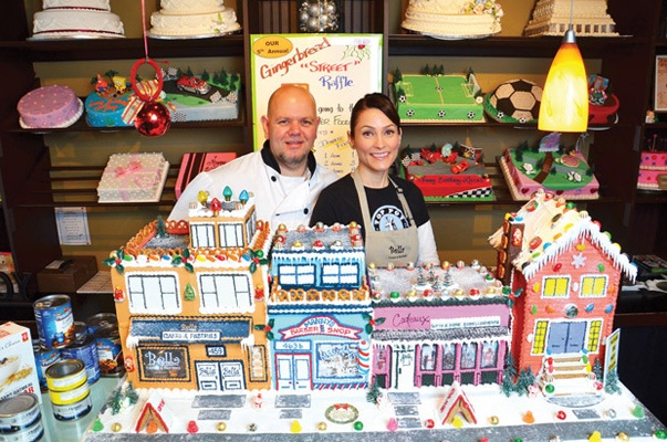 Creating a masterpiece: Fabio and Gina Cornale will be raffling this street of sweet, gingerbread dreams at Bella Cakes and Pastries in Sapperton. Proceeds will go to the food bank.