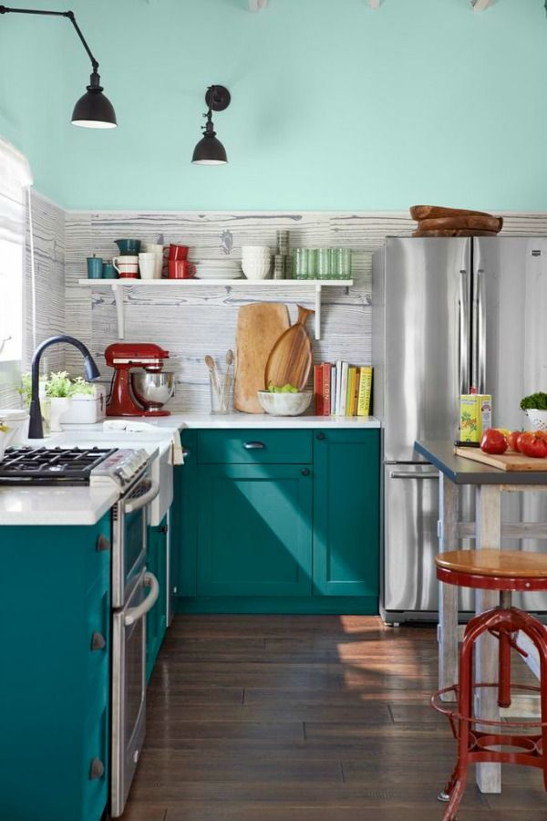 Teal kitchen - unusual wall treatment and cheeky red accents make this a bit of an innovative design.  Teal is not everyone's first choice for the heart of the home but we love the vibrant colours and quirky uniqueness.