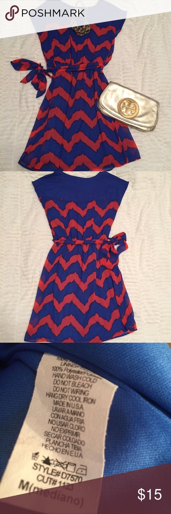"Blue and Orange Chevron Dress Blue and orange chevron dress with tie belt and elastic waist-100 poly- skirt portion is approx 18""-good used condition Francesca's Collections Dresses"