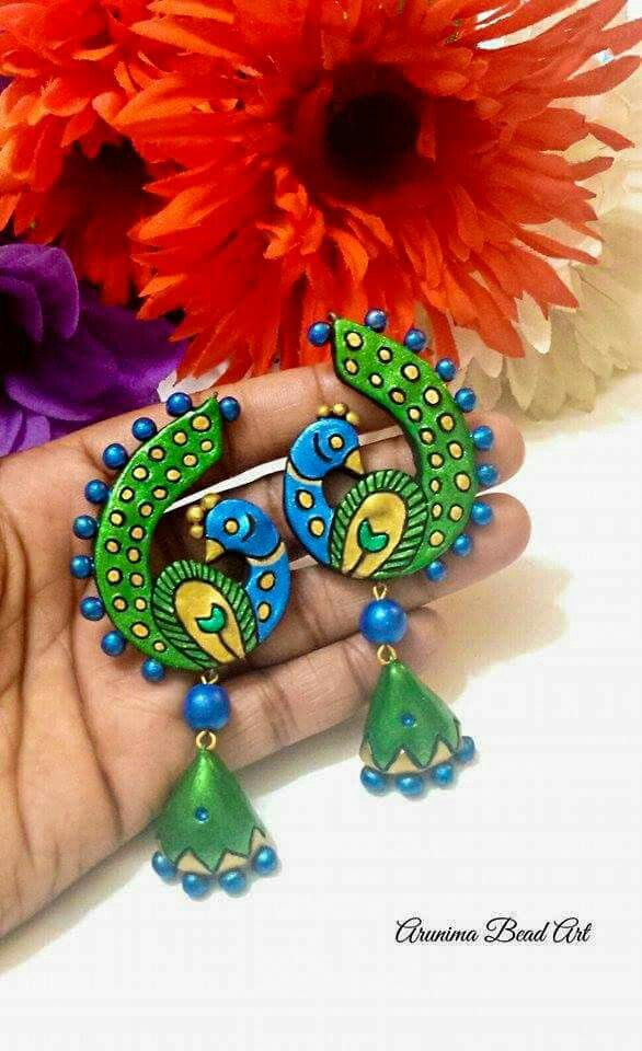 Terracotta peacock earrings... Signature piece from Arunima Bead Art.