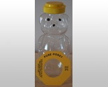 """Empty honey containers filled with teddy grahams and a tag to thank everyone for making the party """"beary"""" special."""