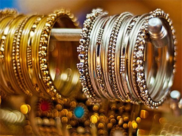 Gold, silver end lower on global cues, subdued demand - The Economic Times
