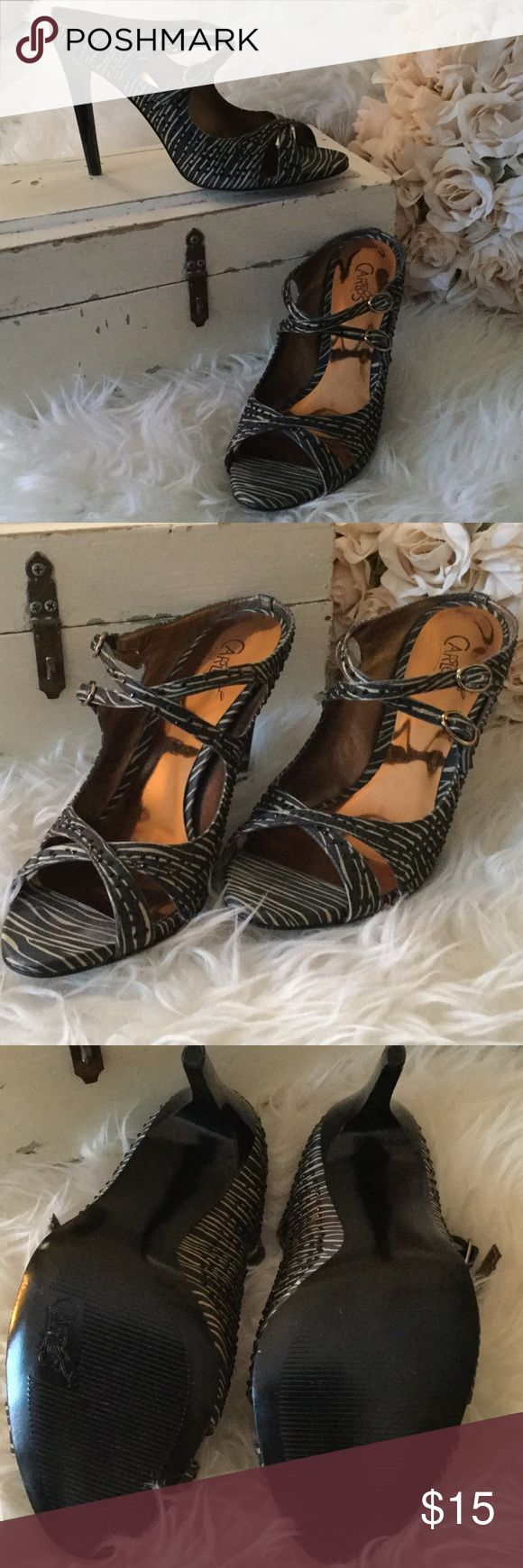 Carlos dress heels Simply beautiful 4 inch heel. Never worn. Pristine condition. Black satin tan strip with tiny adjustable buckles.... and little black sparkle studs....Slip these beauties on and they will be the envy of all the women! Carlos Shoes Heels