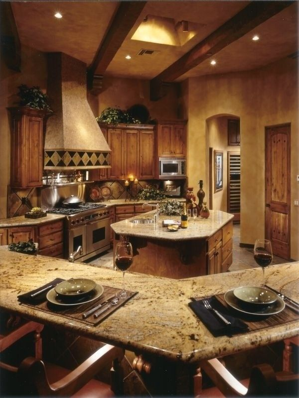 warm and rustic country kitchen -- love the space and layout, hate the lighting (too dim) and the colors (too much wood)