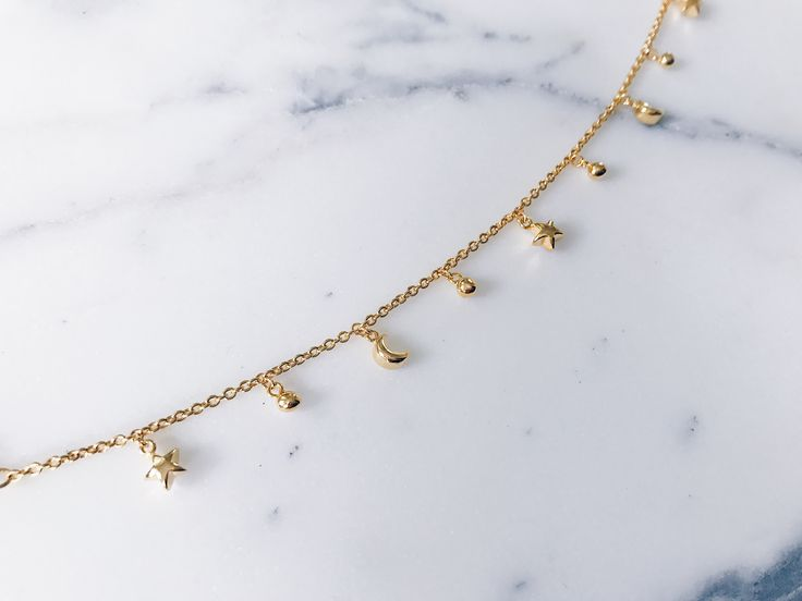 Star moon bracelet in gorgeous gold - Tiny petite stars and moons and little beads hanging on a fine gold chain. Perfect for stacking and layering. SHOP MORE CELESTIAL STAR MOON JEWELLERY BY CLICKING LINK