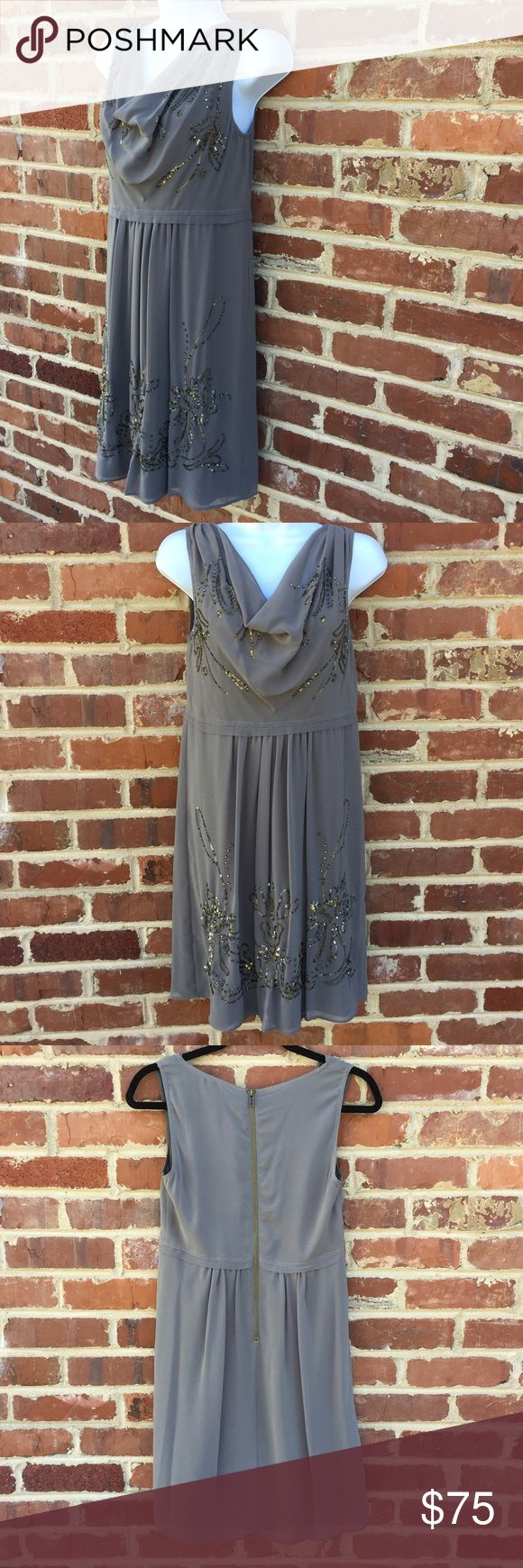 Robbi & Nikki Dress Anthropologie Robert Rodriguez •This neutral-shade dress by Robbi & Nikki has pretty bead embellishments and a flattering cowl neckline. If you want to add even more shimmer, add your favorite matte or metallic belt around the waist. •Gray crepe with gold floral sequin embellishment. •Cowl neckline. •Sleeveless. •Empire waist. •Pleating off waist tapers through layered A-line skirt. •Exposed back zip. •Polyester. •Brand new without tags • Anthropologie…