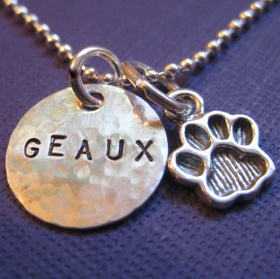 LSU Necklace, Louisiana State University Jewelry, Geaux Tigers, Paw Print Charm Necklace - Hand stamped with whatever text you want!  http://www.etsy.com/listing/59356485/lsu-charm-necklace-hand-stamped-sterling