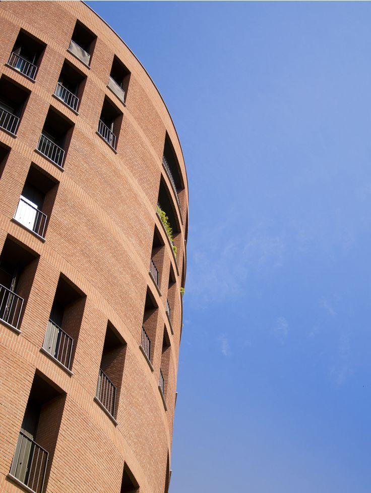 Residential building. Brick wall curve facade in Milan. By Studio Barbieri&Negri
