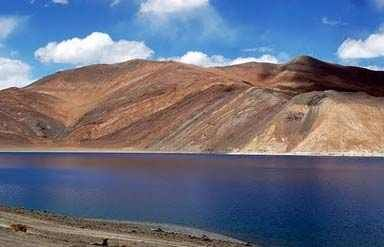 Pangong Lake lies in the northeast of Leh. This famous blackish lake flows another side of the Indo-China border. Travel to the lake from Leh is a unique experience altogether.