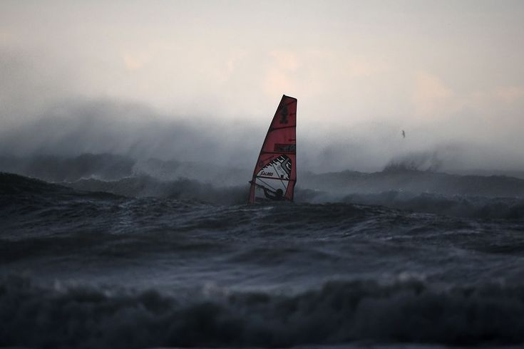 A wind surfer catches waves off Italy's Mediterranean coast west of Genoa on Tuesday Olivier Morin/Agence France-Presse/Getty Images