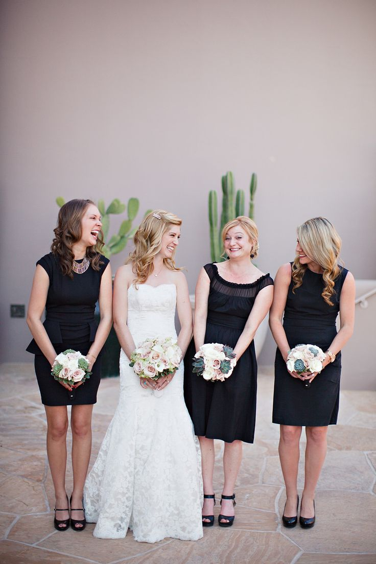 Bridesmaids in their Little Black Dresses - Love it! See the wedding on SMP: http://www.StyleMePretty.com/arizona-weddings/scottsdale/2014/01/28/arizona-desert-wedding-at-the-four-seasons-at-troon-north/