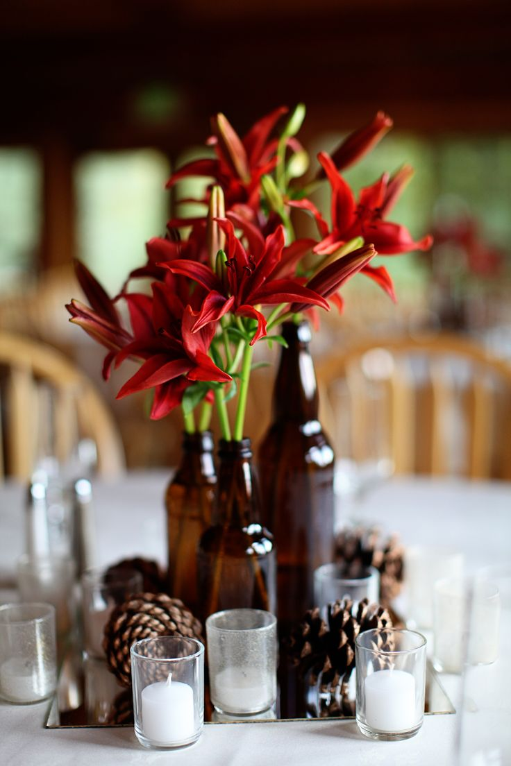 Fall centerpieces, can even use beer bottles...maybe have stalks of wheat instead of flowers inside