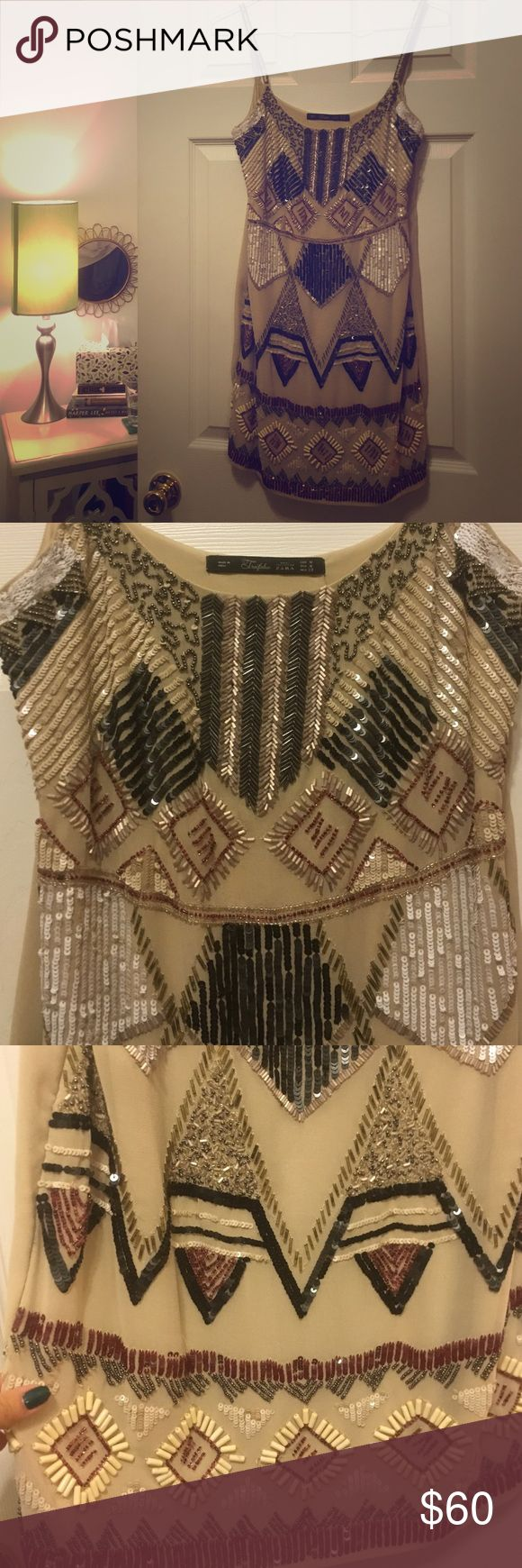 Zara Beaded Aztec Mini Dress Favorite dress of all time!!! Perfect, perfect, perfect for any occasion. Kind of resemble an All Saints beaded dress 😍 Zara Dresses Mini