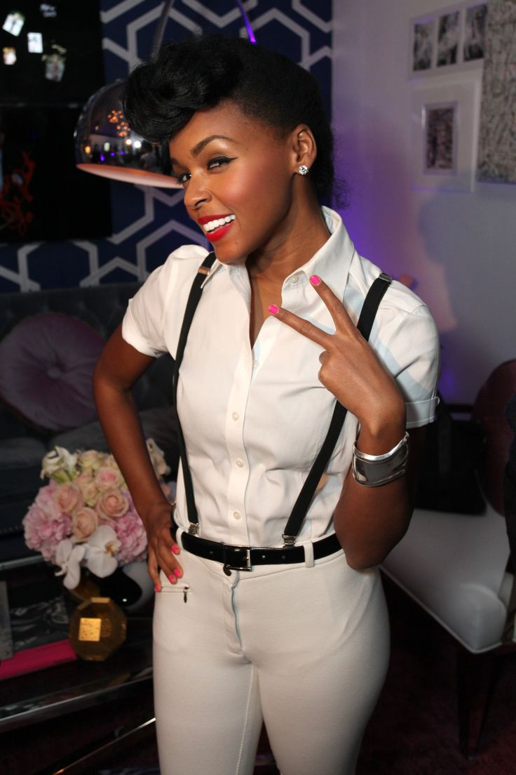 Janelle Monáe's masculine wardrobe, consisting of a black suit, tie, and saddle shoes, has some questioning her sexuality. Description from thefemalecelebrity.com. I searched for this on bing.com/images