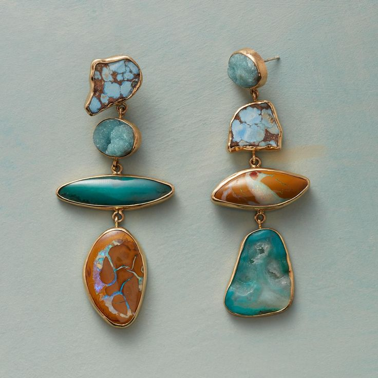 Raw turquoise, hemimorphite, gem chrysocolla and boulder opal stones set in freeform 14kt recycled gold bezels.