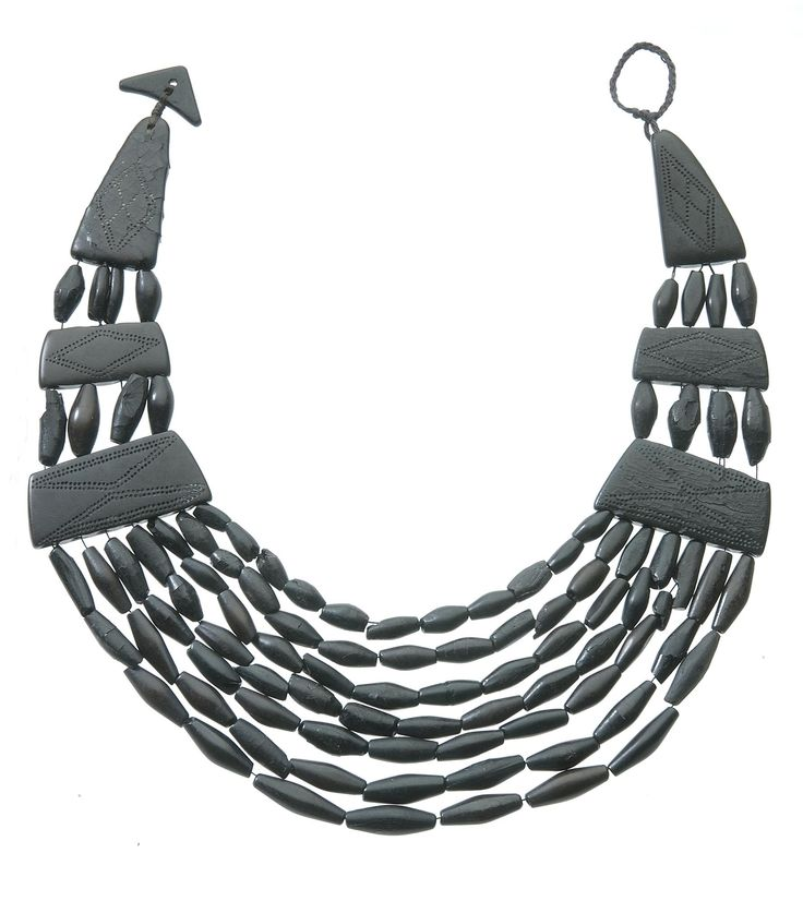 Crescentic jet necklace consisting of 6 engraved spacer plates , a triangular toggle and 110 fusiform beads, from a Bronze Age burial at Killy Kiaran, Kilmartin, Argyll, 2050 - 1800 BC