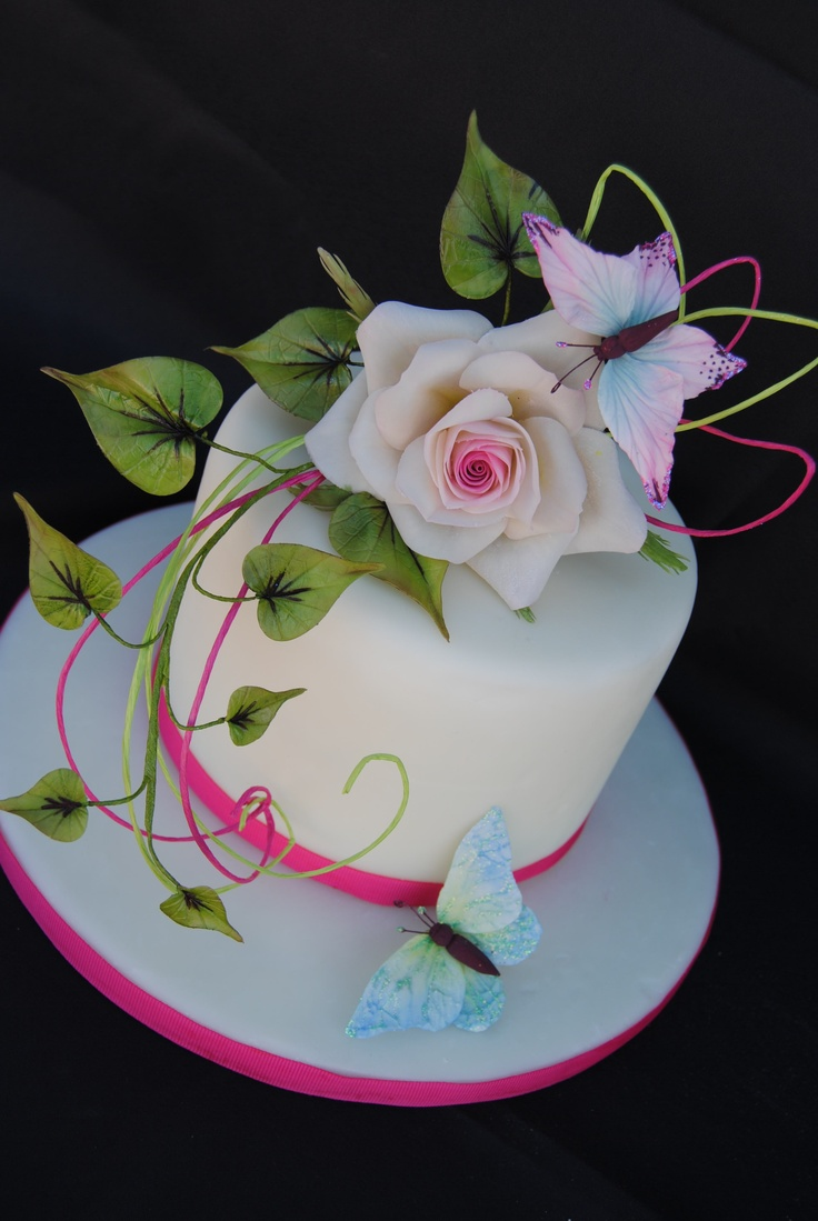 Edible Art. Butterfly on a rose cake.