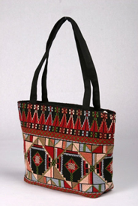 Palestinian embroidered purse This purse is hand embroidered by Atfaluna, the Deaf School in Gaza.