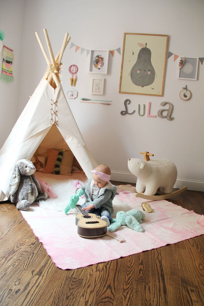 pink and gray pastel baby's room with teepee