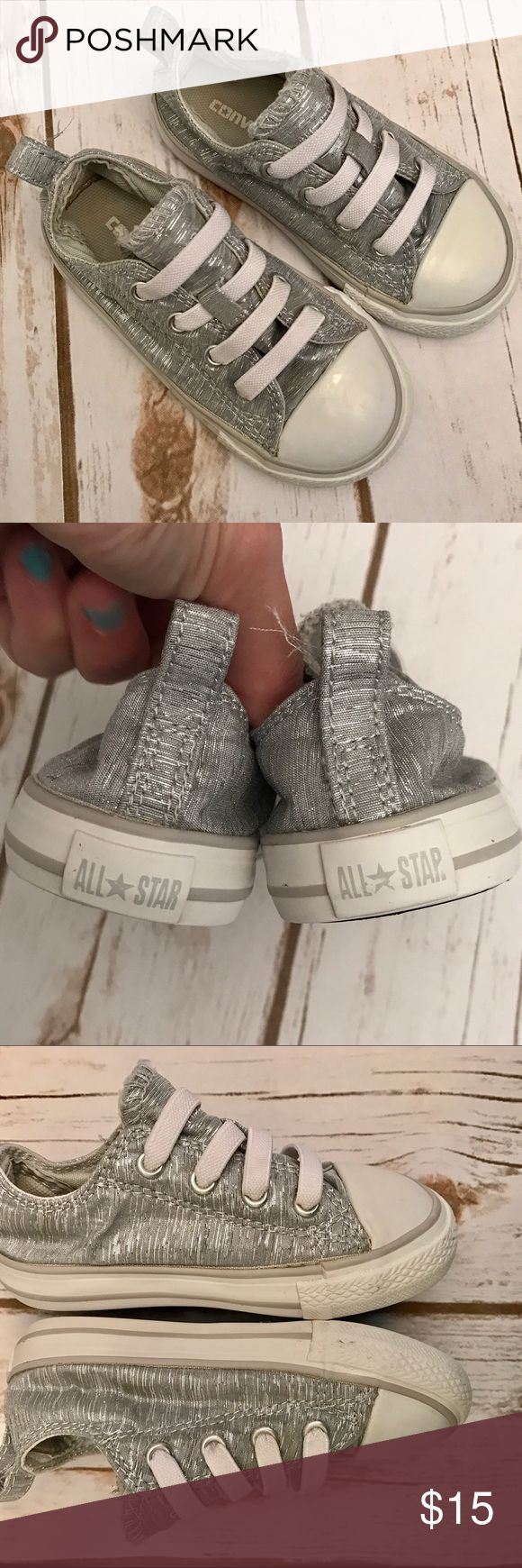 Converse All Stars toddler size 7 In pretty good shape. No laces to tie. Silvery color. Converse Shoes Flats & Loafers