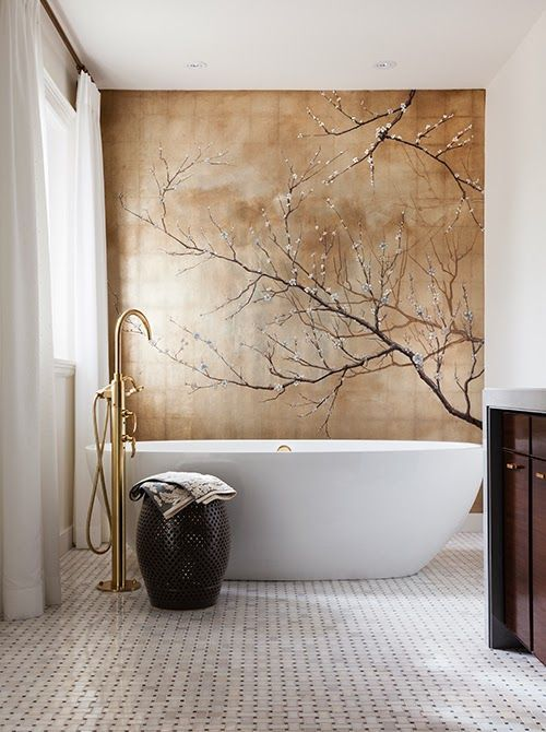 Cool designer alert- Theresa Casey! Gorgeous cherry blossom print (laid over tile?) in this dramatic bathroom. #Gold And White