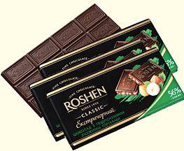 A set of three Roshen extra-dark chocolates with nuts.